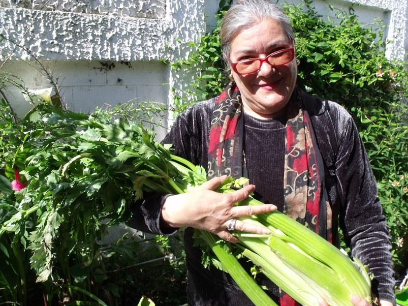 Loreto Fuchslocher holding celery.