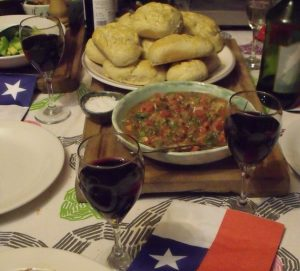 Classic Chilean cuisine: bread, pebre and red wine.
